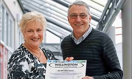 Fr Jeff Drane receives an acknowledgement of his community contribution from the local Member of Parliament, Annette King.
